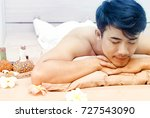 young asian man relaxing on... | Shutterstock . vector #727543090