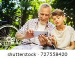 the old man and his grandson... | Shutterstock . vector #727558420