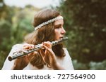 beautiful young woman dressed... | Shutterstock . vector #727564900