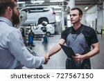 handsome businessman and auto... | Shutterstock . vector #727567150