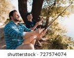 a man in a blue shirt and an... | Shutterstock . vector #727574074