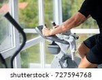 young man exercise bike ... | Shutterstock . vector #727594768