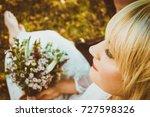 bride showing off her beautiful ... | Shutterstock . vector #727598326