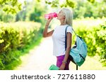 photo of athletic girl drinking ... | Shutterstock . vector #727611880