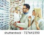 happy family choosing glasses... | Shutterstock . vector #727641550