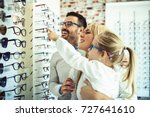 happy family choosing glasses... | Shutterstock . vector #727641610