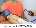 doctor checking blood pressure... | Shutterstock . vector #727645834