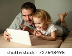 father and son watching... | Shutterstock . vector #727648498