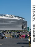 Small photo of New Jersey - Circa 2017: Metlife Stadium exterior day photo during parking lot tailgate before New York Jets football game sporting event