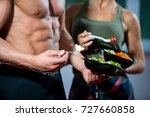 happy couple in gym feeding... | Shutterstock . vector #727660858