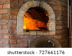 fire in stone oven. oven made... | Shutterstock . vector #727661176