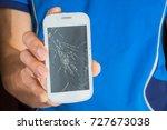 a young man holding a broken...   Shutterstock . vector #727673038