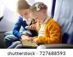 adorable little girls traveling ... | Shutterstock . vector #727688593