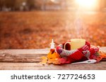 tea mug covered with warm scarf ... | Shutterstock . vector #727724653