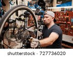 bicycle mechanic in a workshop...   Shutterstock . vector #727736020