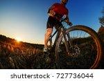 portrait of cyclist standing... | Shutterstock . vector #727736044
