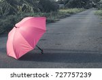 Pink Umbrella On Concrete Floor ...