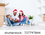happy young couple in santa... | Shutterstock . vector #727797844