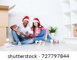 happy young couple in santa... | Shutterstock . vector #727797844