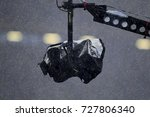 video camera is wet due to rain. | Shutterstock . vector #727806340