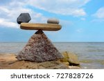 symbol of scales of the stones... | Shutterstock . vector #727828726