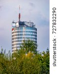 Small photo of The Uniturm, Jentower in Jena from the river Saale