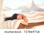 spa. woman getting spa lastone... | Shutterstock . vector #727869718