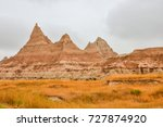 Badlands are a type of dry terrain where softer sedimentary rocks and clay-rich soils have been extensively eroded by wind and water.