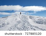 skier with skis on his shoulder ... | Shutterstock . vector #727885120