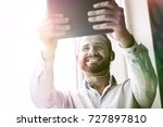 smiling businessman with... | Shutterstock . vector #727897810