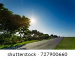 empty asphalt country road... | Shutterstock . vector #727900660