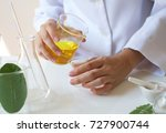 scientist pouring the oil in... | Shutterstock . vector #727900744