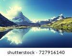 reflection of matterhorn in...   Shutterstock . vector #727916140