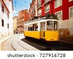 yellow tram on narrow street of ...   Shutterstock . vector #727916728