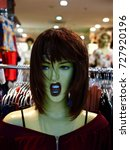 Small photo of Unusual Snarling Shop Mannequin with a Vacuous Gaping Mouth.