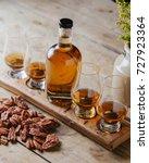 whiskey flight on rustic wooden ... | Shutterstock . vector #727923364