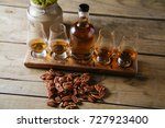 whiskey flight on rustic wooden ... | Shutterstock . vector #727923400