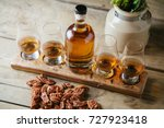 whiskey flight on rustic wooden ... | Shutterstock . vector #727923418
