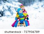 little girl and boy enjoy a...   Shutterstock . vector #727936789