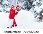 children build snowman. kids... | Shutterstock . vector #727937020