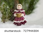 Small photo of Caroler sing in the snow fall