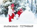 Children Build Snowman. Kids...