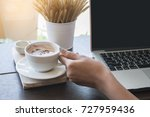 women hand holding a cup of... | Shutterstock . vector #727959436