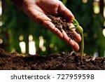 hands of farmer growing and... | Shutterstock . vector #727959598