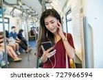asian woman passenger with... | Shutterstock . vector #727966594