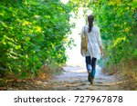 the girl walks along the path... | Shutterstock . vector #727967878