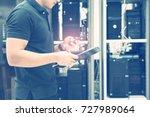 hands of the technician... | Shutterstock . vector #727989064