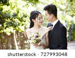 young asian groom kissing bride ... | Shutterstock . vector #727993048