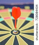 Small photo of Close up dart on magnet board with blur abd bokeh background