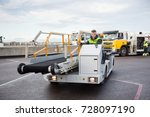 male worker driving luggage... | Shutterstock . vector #728097190